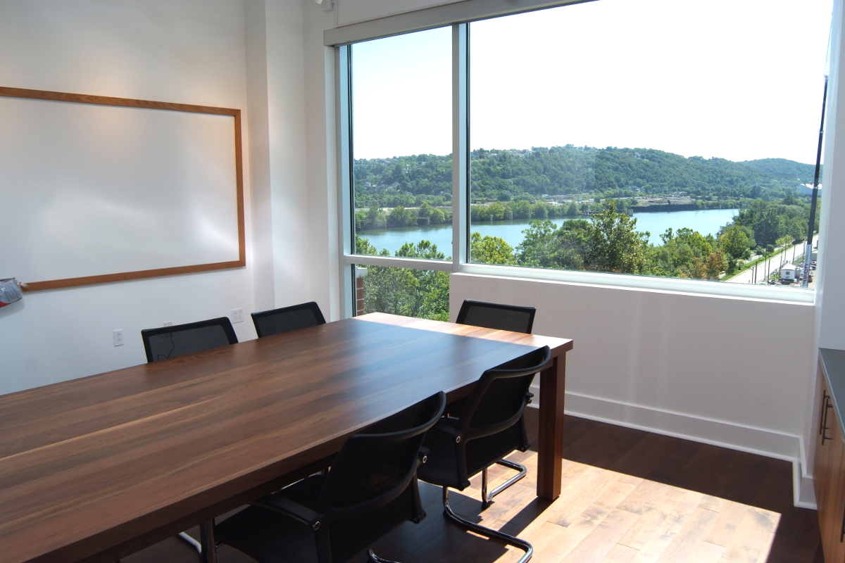 conference room, wood table, large window