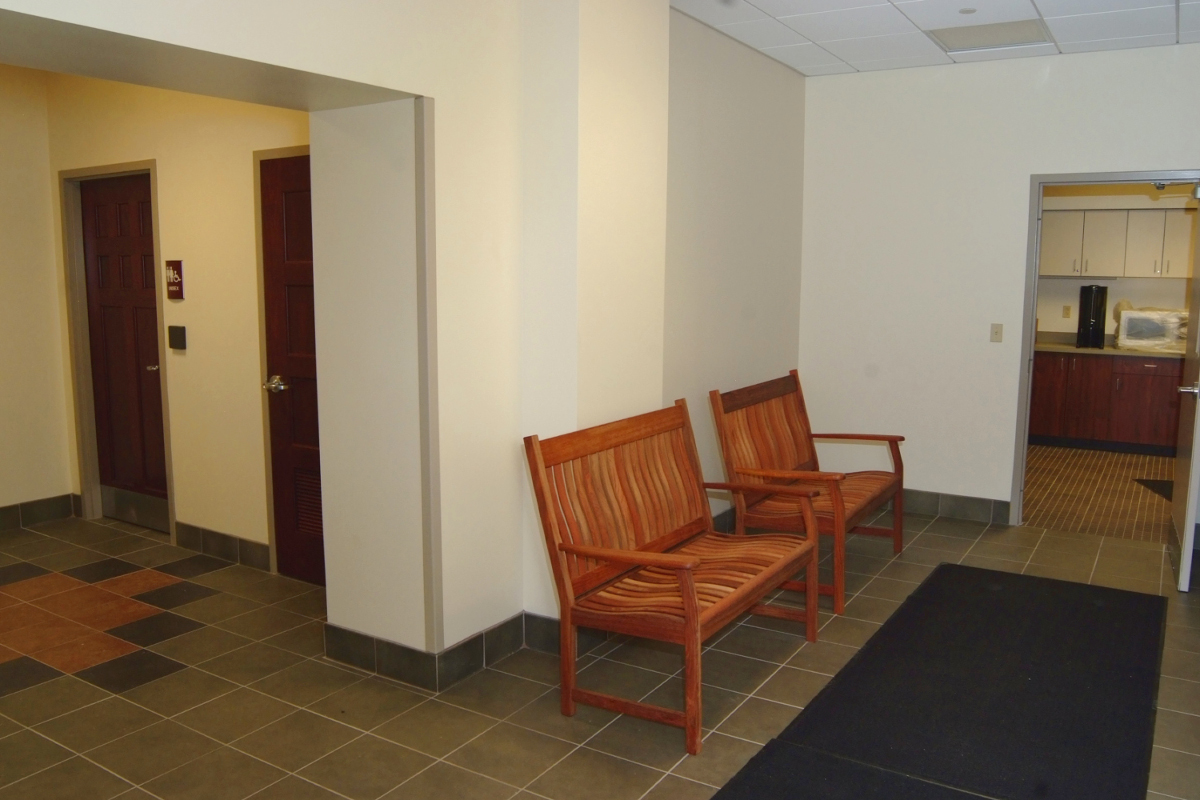 Restrooms and hallway with benches
