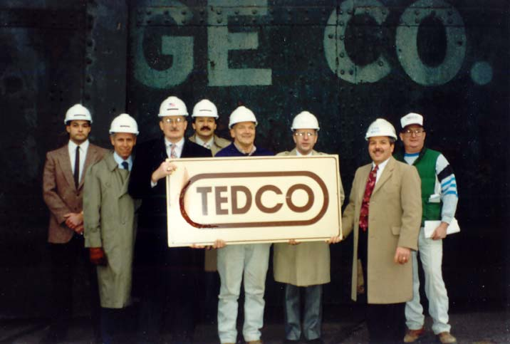Group with first TEDCO logo sign
