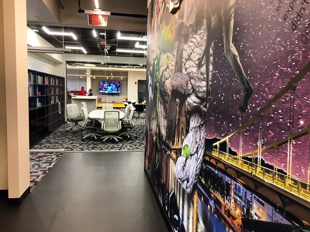 Custom artwork leads into a conference area